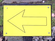 Yellow arrow sign pointing this way left Royalty Free Stock Photography