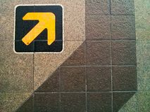 Yellow arrow. Sign  is warning on the floor Stock Images