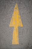 Yellow Arrow signs on the road Stock Image