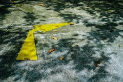 Yellow arrow traffic sign on road. royalty free stock photography