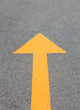 Yellow arrow up on asphalt street. For the concept of choice Stock Image