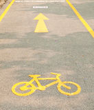 Yellow arrows and bicycle sign Royalty Free Stock Image