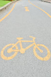 Yellow arrows and bicycle sign path Royalty Free Stock Image