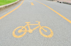 Yellow arrows and bicycle sign path Stock Photography