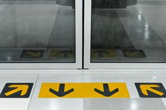 Yellow arrows indicate the entrance to the subway exit door. Royalty Free Stock Photos