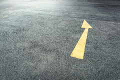 Yellow  arrows on the street Royalty Free Stock Images