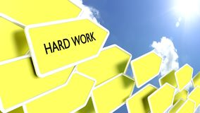 Yellow arrows with the words hard work Stock Image