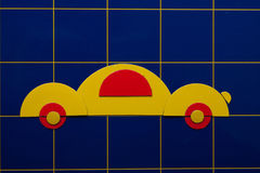 Yellow art  illustration of car on blue background Royalty Free Stock Photo