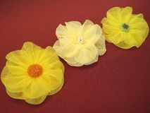 Yellow artificial fabric flowers Stock Photos