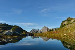 Yellow Aster Butte and the Border Peaks. Camping by the tarn at Yellow Aster Butte Royalty Free Stock Image
