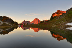 Yellow Aster Butte and the Border Peaks. Camping by the tarn at Yellow Aster Butte Stock Images