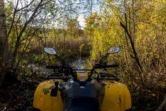 Yellow ATV in the autumn forest, Nizhny Novgorod region, Russia Royalty Free Stock Photos