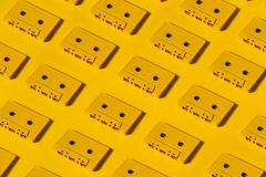 Yellow Audio Cassette Tapes On Yellow Background. Creative Concept Of Retro Technology Pattern Stock Images