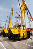Yellow auto crane Stock Image