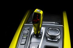 Yellow Automatic gear stick of a modern car. Modern car interior details. Close up view. Car detailing. Automatic transmission lev royalty free stock photography
