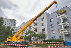 Yellow automobile crane with risen telescopic boom Royalty Free Stock Photo
