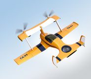 Yellow autonomous flying drone taxi flying in the sky Stock Image