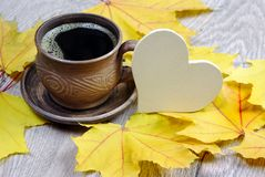 Yellow autumn leaf of maple and a cup of coffee. Top view stock photography