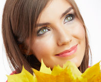 Yellow autumn leaves, close up woman face. Portrait Royalty Free Stock Photos