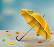 Yellow autumn umbrella with fallen leaves. Realistic yellow umbrella on the ground, in water puddle, after rain, with autumn leaves. Vector illustration for Royalty Free Stock Photos