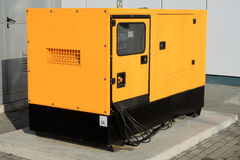 Yellow Auxiliary Diesel Generator for Emergency Electric Power Royalty Free Stock Photos