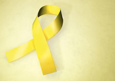 Yellow awareness ribbon Royalty Free Stock Images