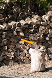 Yellow axe for chopping firewood Stock Photography