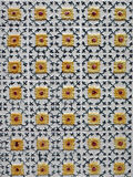 Yellow Azulejos Porto. Small earthenware tiles painted and hand-decorated, the Azulejos is an ancient art in Portugal. It serves as decoration (inside and Stock Photo
