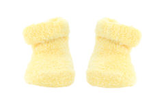 Yellow Baby Booties. Cute little yellow baby booties isolated on white Royalty Free Stock Photos