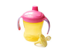Yellow baby bottle with pacifier. A white background Stock Image