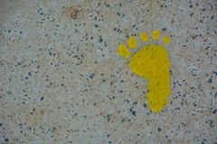 Yellow baby foot-print Stock Images