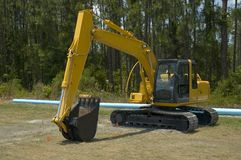 Yellow back hoe. Royalty Free Stock Images