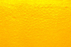 Yellow background. Warm yellow vivid abstract glass background Royalty Free Stock Images
