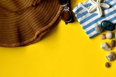 Yellow background with beach accessories, hat, sunglasses, shirt royalty free stock photography
