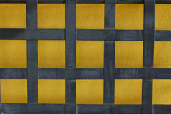 Yellow background with blue striped on a wall Royalty Free Stock Image