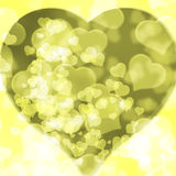 Yellow background blurred lights heart. Yellow background of blurred lights in the shape of a heart Royalty Free Stock Image