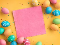 Yellow background with colorful easter eggs. Happy Easter! Yellow background with colorful easter eggs. Top view with copy space Royalty Free Stock Photo