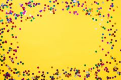 Yellow background with confetti and place for your text. Copy place royalty free stock photos