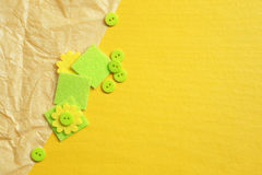 Yellow background with crumpled paper, green buttons and squares Royalty Free Stock Image