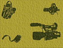 Yellow background with filming equipment. Abstract textured illustration with movie equipment and film reel Stock Images