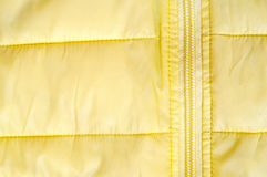 Yellow background with fragment jacket Royalty Free Stock Images