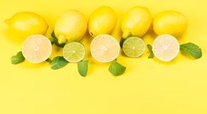 On a yellow background, fruit lemons and barking together Stock Photography