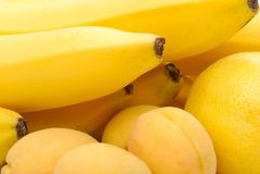 Yellow background of fruits Stock Images