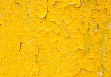 Yellow background with old paint Stock Images