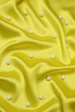 Yellow background with pearls Royalty Free Stock Photos