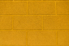 Yellow ocher wall. Picture of yellow wall of a modern building stock images