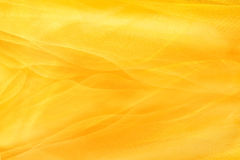 Yellow background textiles Stock Image