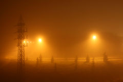 Yellow background of an urban foggy night. Foggy and misty urban night under yellow lights. For yellow background and textures Royalty Free Stock Image