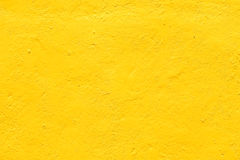 Yellow background wall textures rough. Yellow wall background with textures Royalty Free Stock Photos
