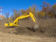 Yellow backhoe Stock Images